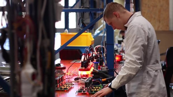 Engineer working on manufacturing obstacle lights